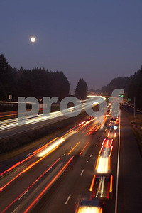 Heavy traffic under a full moon on I-5 in Washington State.