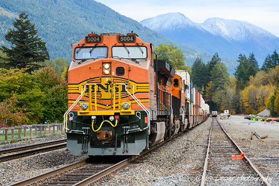 BNSF freight train at Skykomish with distant first snow