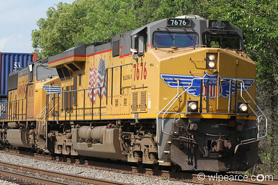 All American!  Union Pacific  7676 on track maintenance hold in Tallahassee. Notice the Engineer waving a paper out the window.  He wanted a copy of the pic.  We obliged.
