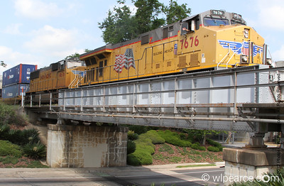 Union Pacific  7676.   on the Monroe St. Bridge in Tallahassee, FL.  Engineer giving me a wave...
