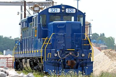 Blue and yellow train at a limestone company