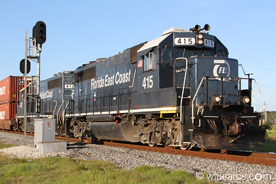 Florida East Coast #415 and #412 running the intermodal up to Jacksonville, passing through the marsh in St. Augustine.
