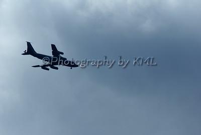 Plane Silhouette Against Dark Clouds
