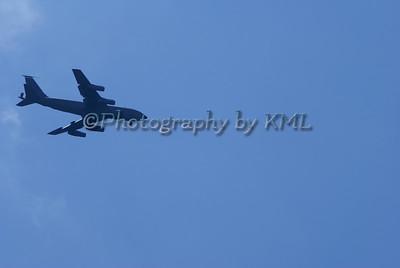 Plane Silhouette Against Blue Sky