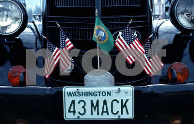 A 1943 mack truck flying the American flag.