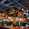Old Ford Hangs over Bar inside Ford's Garage