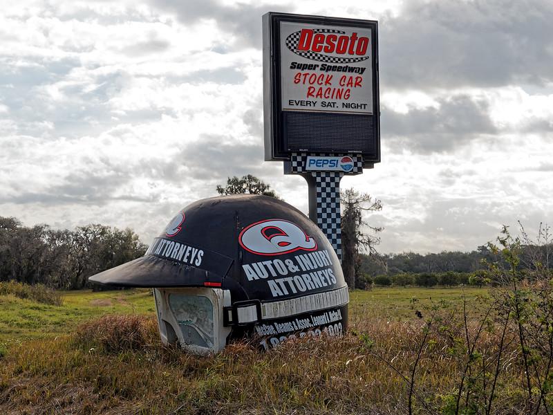 Large Racer's Helmet on Side of Road
