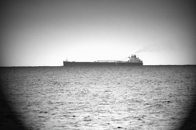 Great Lakes freighter on Lake Erie in black and white.