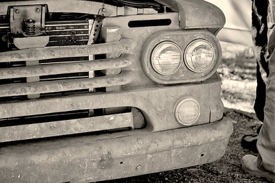 Front Grill of a Rusty Old Truck in Black and White