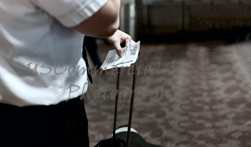 Man holding Boarding Passes