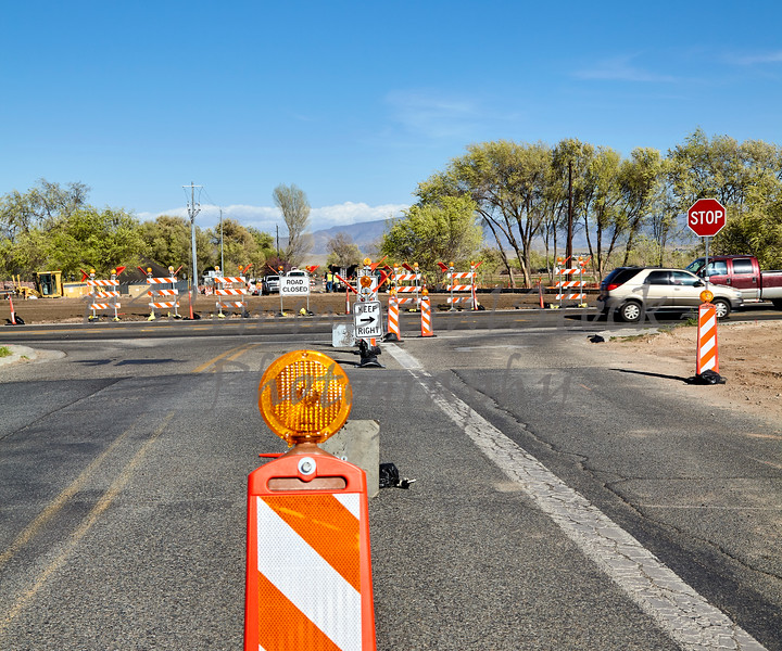 construction highway roadwork traffic control signs and detour men at work