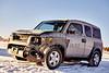 Car damage from deer crash in snow
