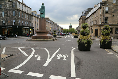 At Castle Street looking west, the cyclists have to go round the island.   It's all rather 'Cycling by Design'