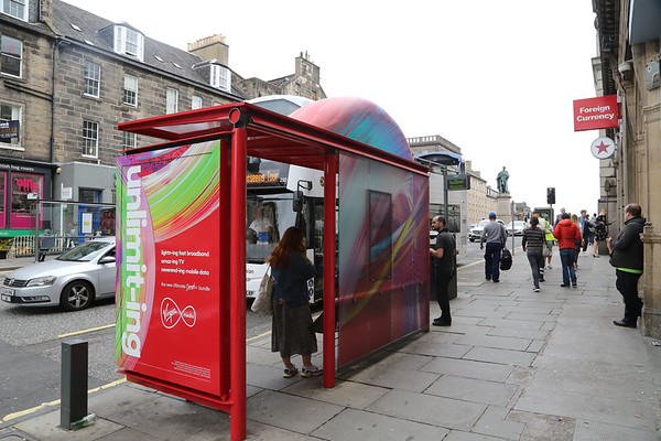 Virgin TV advert wrap on a bus shelter on Hanover Street