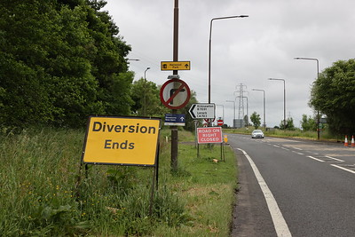 'Road on Right Closed' serves no purpose, as it is not possible to make a right turn in the first place. A71 at the B7031 staggered junction looking west to Livingston. The No Entry sign is facing the westbound A71 traffic but is meant to protect vehicles using the right turn lane towards Edinburgh from the B7031 south arm.