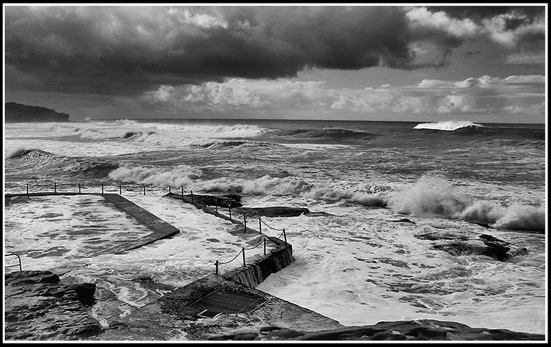 153) Storm over North Curl Curl	Murray Lowe		RELCC	4	4	8<br /> Here is a good example of a visible effect of strong weather - strong seas.   I wonder if the composition would be stronger by cropping the bottom of the image up to the pool edge; removing the 'heaviness' and increasing the importance of the swirling sea in the image?