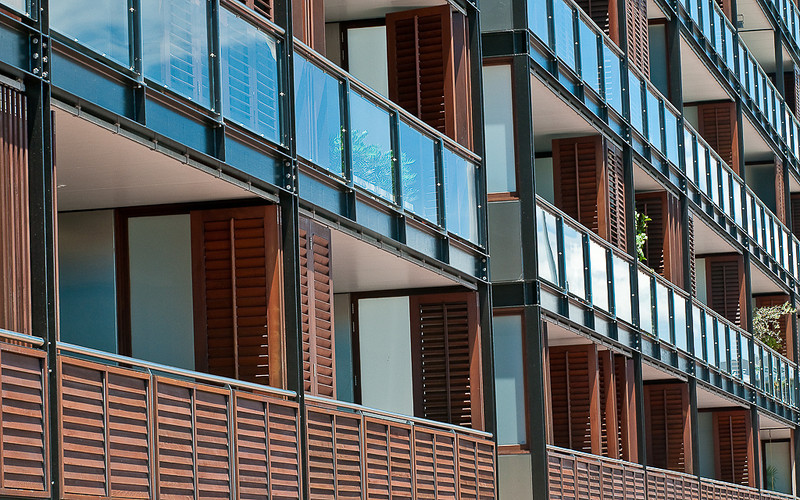 """ balconies ""  By  Keith Forster.<br /> <br /> The richness and warmth of the timber intersected by the glass of the balcony makes for an captivating pattern shot.	10"