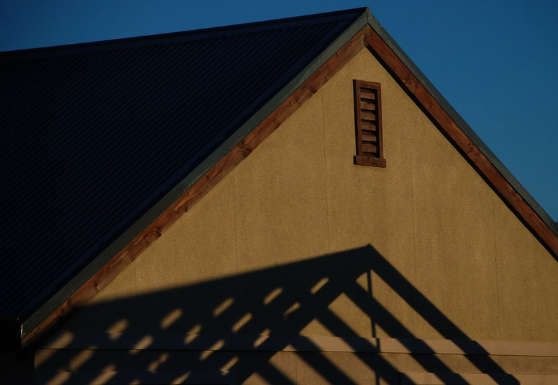 """ Lines And Angles ""  By  Allen Ford.<br /> <br /> I like the way the author has managed to include the structural frame in the shadows, echoed by the completed roof. The low light has produced nice tones but the image overall needs to be brightened slightly.	12"