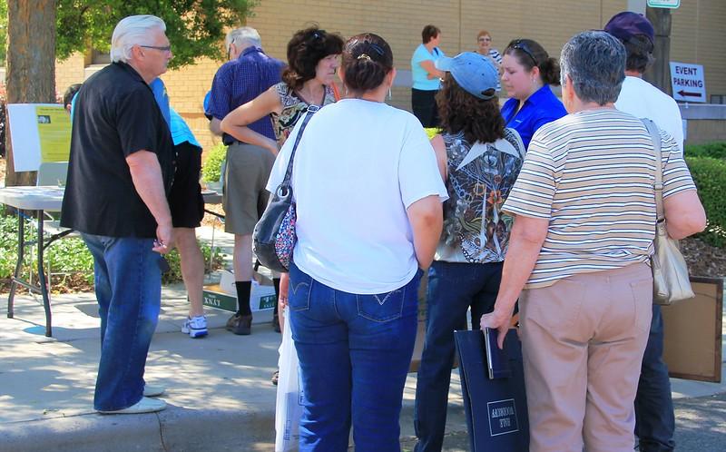 HPC member Kathryn McClelland (blue shirt) explains the process.