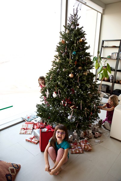 Spirits are high as the girls encircle the Christmas tree (imported from Nova Scotia).