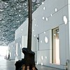 "The interior courtyard features a sculpture called ""Leaves of Light--Tree."" Here it also features three four-year-olds."