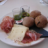 Sunday lunch: Eliot's Spanish cold cuts and cheese with pesto, olive oil, and tiny  rolls. Looks like a painting, doesn't it!