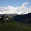 Snow above Tschlin in early September.  Austria ahead, Italy to the right.