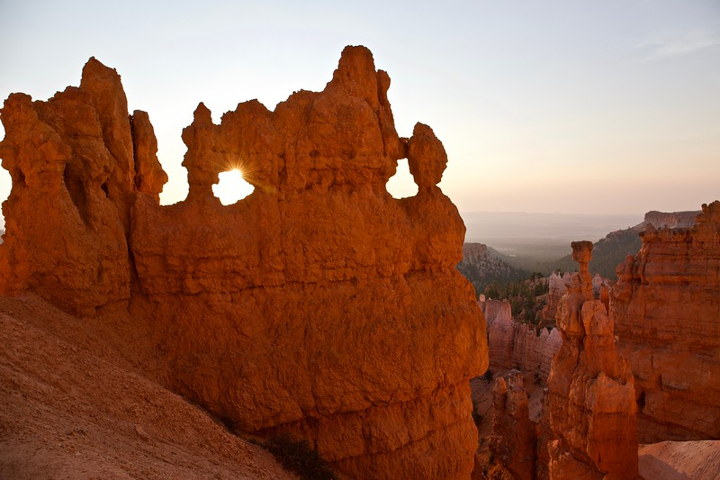 where the sun shines through windows in the rock.