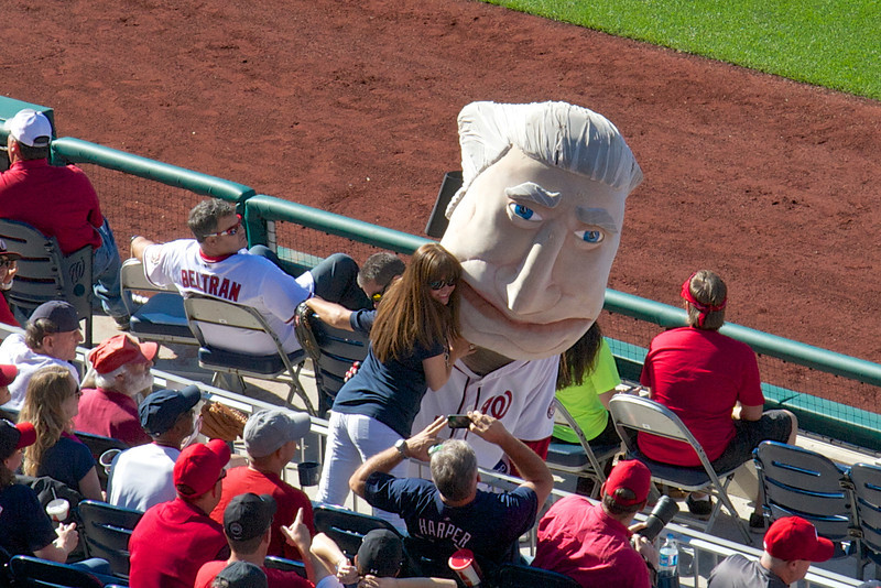 """Hugging """"George,""""  at the Nationals' game"""