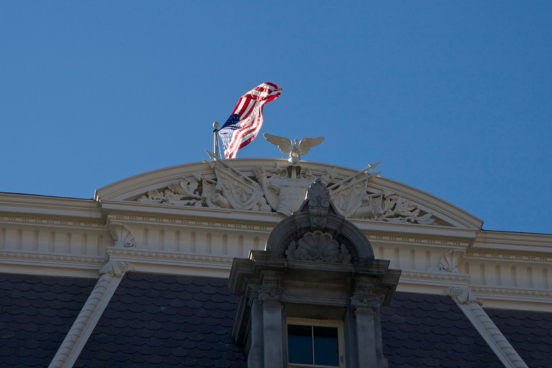American flag over the Executive Office Building