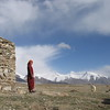 Farm girl in front of her hut and goat at 4530m. Mt. Kongur, Xinjiang, China