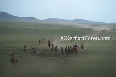 Mongolia, Ulan Bator: Jockeys as they near the finish line of a horse race.