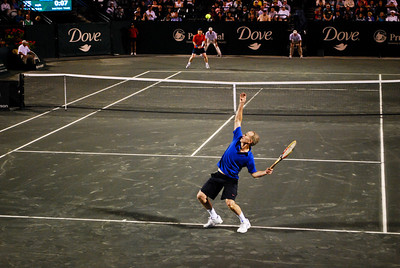 John McEnroe serving to Jim Courier at the Family Circle Cup - Charleston, SC.