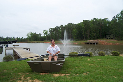 Aunt Nancy trying out her new row boat at Granger Hill, Equality, AL