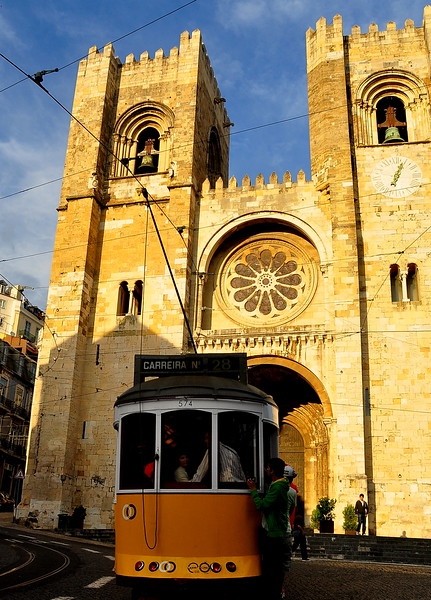 The cathedral (Se) of Lisbon.  Oldest building in Lisbon. The tram is likely just as old.  :-P