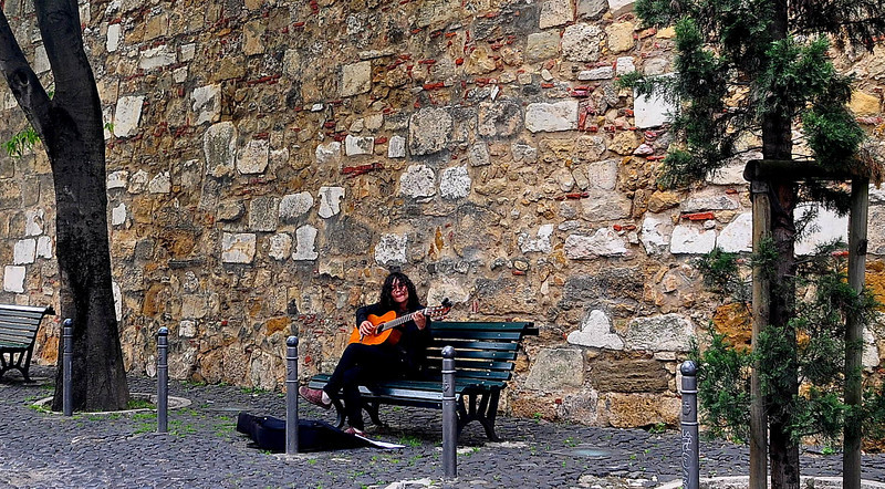 Walking up to the Castelo de Sao Jorge, Lisbon.  There were a lot of street musicians in Lisbon.