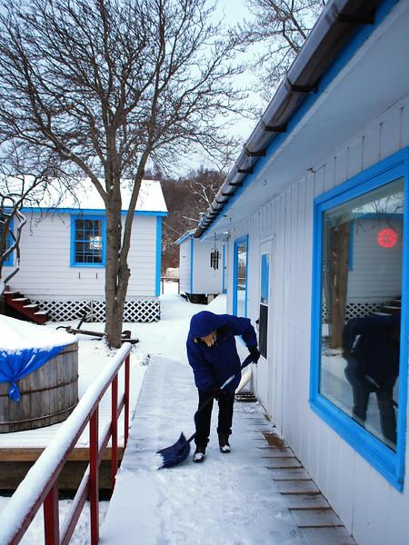 Pam snow shoveling front walk