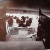 Historic photo of troops leaving landing craft on Omaha beach. June 6, 1944