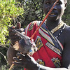 Fresh kill of a Mousebird by a Bushman of the Hadzabe tribe - Lake Eysia, Tanzania