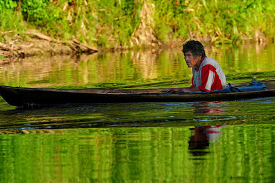 Old Man in Canoe