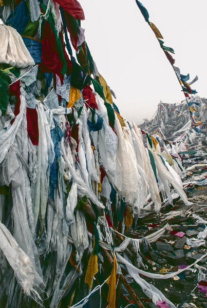 Prayer flags, rubbish and mist