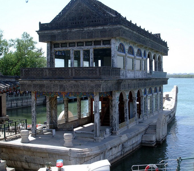 The Marble Boat, also known as the Boat of Purity and Ease  is a lakeside pavilion. Of course, it's not solid marble, it is made out of wood painted to imitate marble.  It's faked!