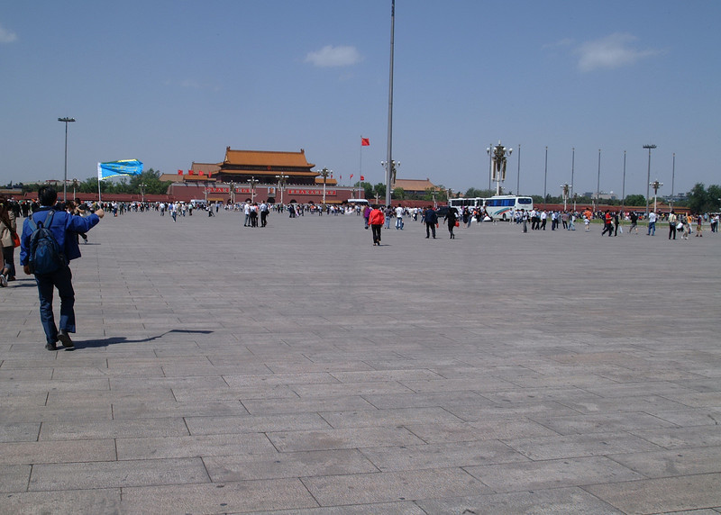 Tiananmen Square in Beijing - named after the Tiananmen (literally, Gate of Heavenly Peace) which sits to its north, separating it from the Forbidden City.<br /> The square is 880 metres (2887 feet) south to north and 500 metres (1640 feet) east to west, a total area of 440,000 square metres (108.7 acres), which makes it the largest open-urban square in the world.
