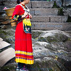 Young girl in Traditional Dress on the banks of the Toujiang River