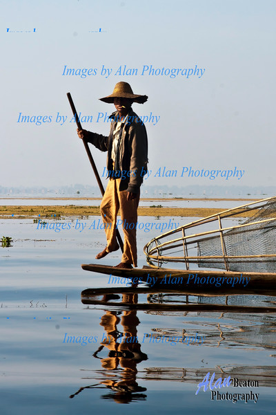 Leg-rowing fisherman on Inle Lake