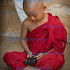 Young monk with digital device, Bagan, Myanmar