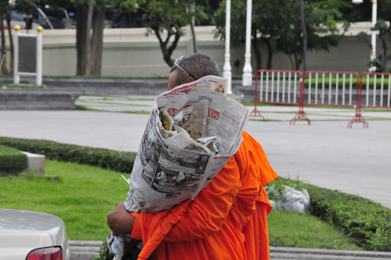 Bangkok street scenes - Monk and his purchase at the Flower market