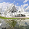 Wat Rong Khun, more well-known among foreigners as the White Temple, is a contemporary unconventional Buddhist temple in Chiang Rai, Thailand. It was designed by Chalermchai Kositpipat in 1997.