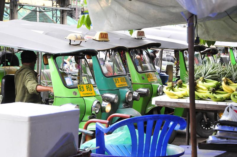 Khao San Road - Bangkok's backpackers mecca -- Tuk-tuks (bike taxi) waiting for a fare