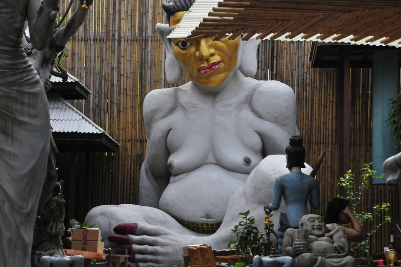 Khao San Road - Bangkok's backpackers mecca -- statues at one of the outdoor cafes